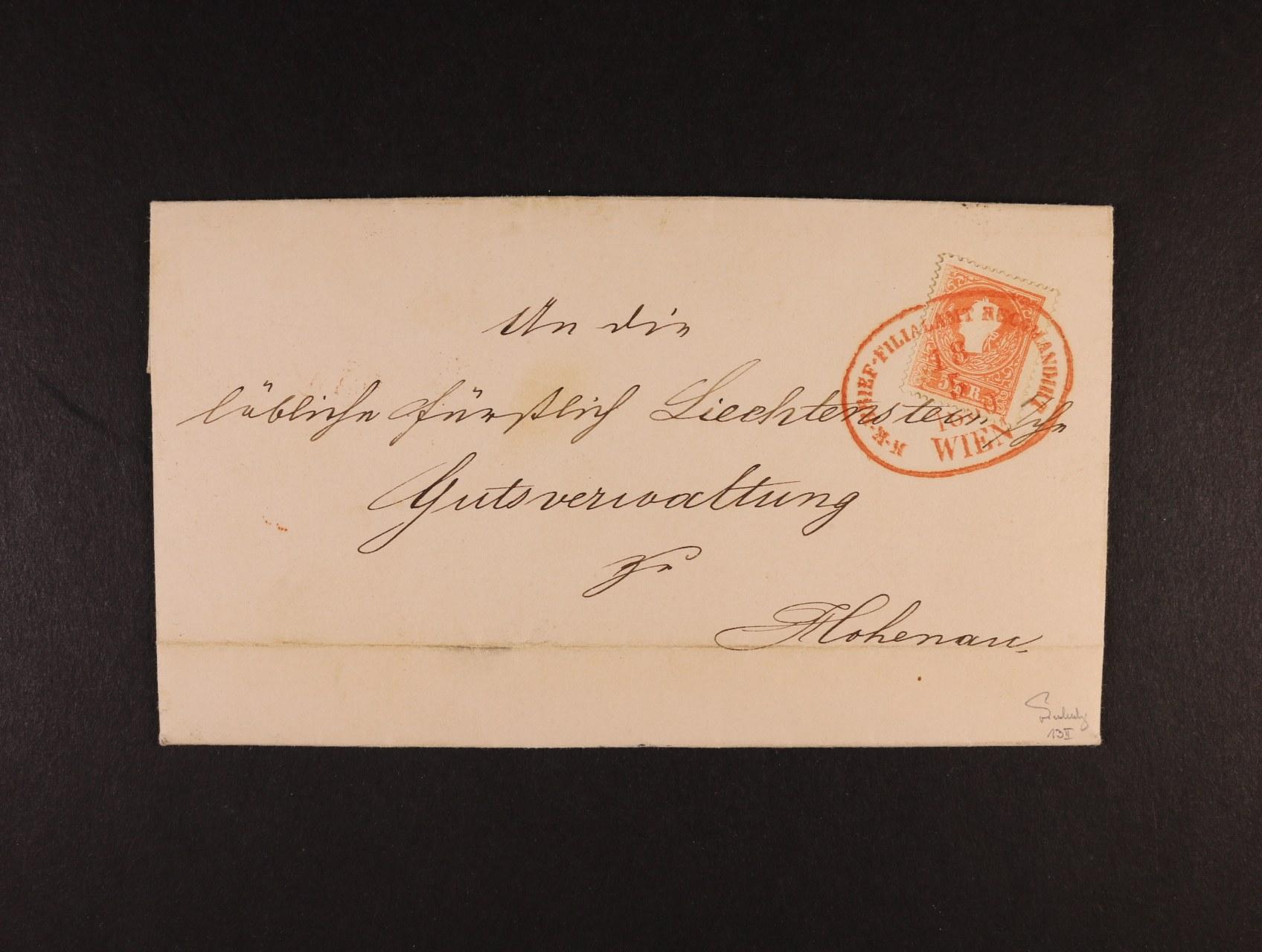skl. R-dopis do Hohenau z r. 1860 frank. zn. Fe. č. 13 II s oválným červeným raz. K.K. ... RECOMANDIRT WIEN 18.5.86, na zadní str. při otevírání zn. stržena, přích. raz. zk. Ferchenbauer