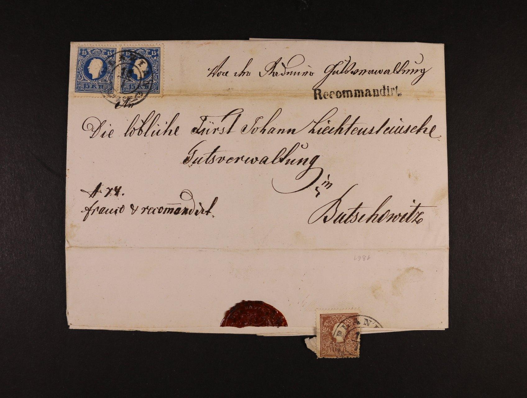 skl. R-dopis do Bučovic z r. 1861 frank. na přední str. zn. Fe. č. 15 II (2x), na zadní str. zn. Fe. č. 14 II, pod. raz. PLANIAN 15.1., v horní části registr. lom, řádk. raz. RECOMMANDIRT