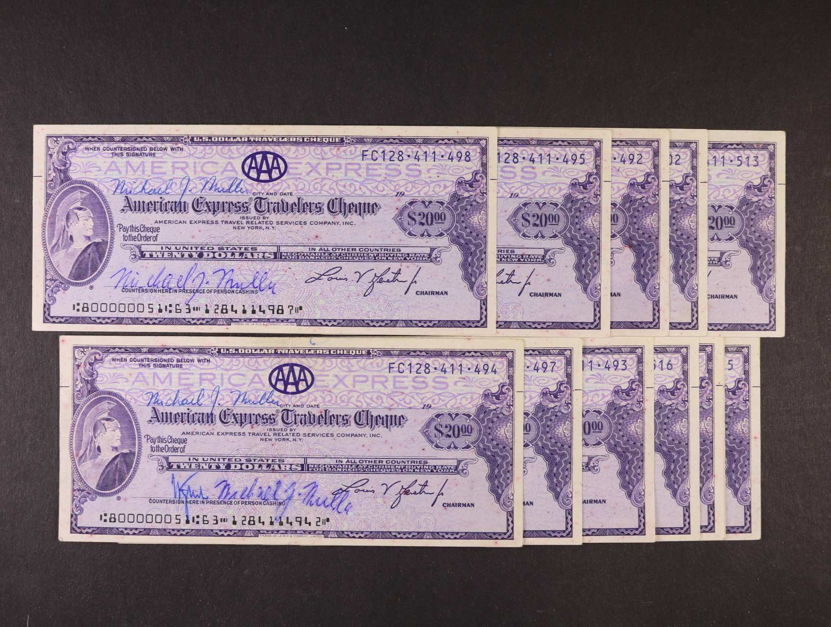 14 ks cestovních šeků 20 USD American Express, všechny vypsané